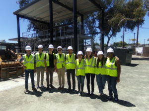 2016 REUs in hard hats and safety vests at Codiga Center